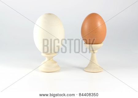 Wood And The Usual Eggs On A Stand Next To A White Background
