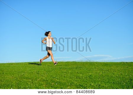 Sporty Woman Running Outdoor At Grass Field