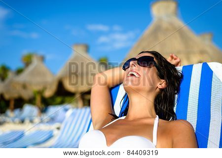 Woman On Relaxing Vacation At Tropical Resort Beach Sunbathing