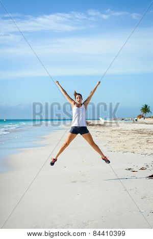 Sporty Woman Jumping At Beach