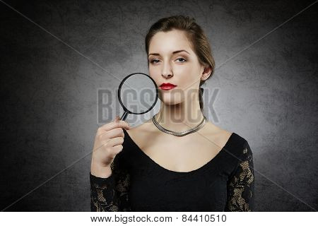 Attractive woman with magnifying glass