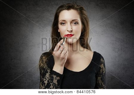 Attractive young woman with red lipstick