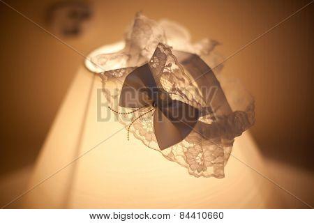 Wedding garter lace on lamp