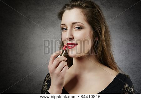 Cute smiling woman with red lipstick