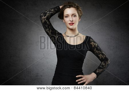 Seducing woman in black lace dress