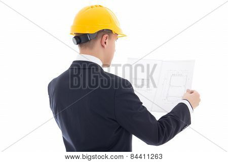 Back View Of Business Man In Yellow Builder's Helmet With Blueprint Isolated On White