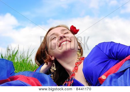 Gipsy Girl In Blue, Lying On Green Grass