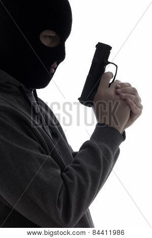 Dark Silhouette Of Burglar Or Terrorist In Mask With Gun Isolated On White