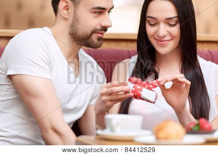 Beautiful young couple in the cafe