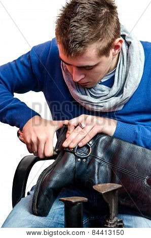 Shoemaker Repairing A Heel On White Background