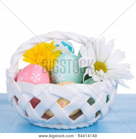 Easter Eggs In A Basket On White Background