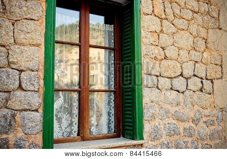 Traditional old window in the historic village Deia in Majorca