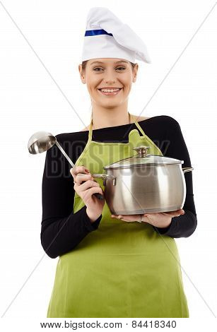 Young Woman Cook With Pot And Soup Ladle