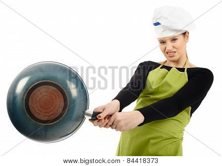 Furious Woman Cook Hitting With The Frying Pan