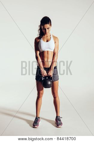 Young Woman Exercising Crossfit With Kettle Bell