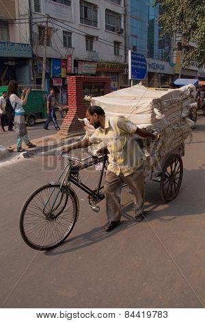 Delhi, India - November 5: Unidentified Cycle Rickshaw Walks With Goods On November 5, 2014 In Delhi