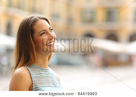 Cheerful Tourist Woman Looking At Side In A Touristic Place