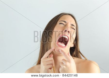 Girl Crying While Pressing A Pimple On Her Chin
