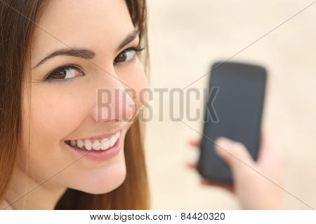 Portrait Of A Smiley Woman Using A Smart Phone