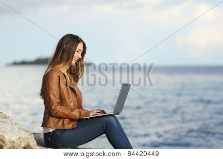 Self Employed Woman Working With A Laptop On The Beach