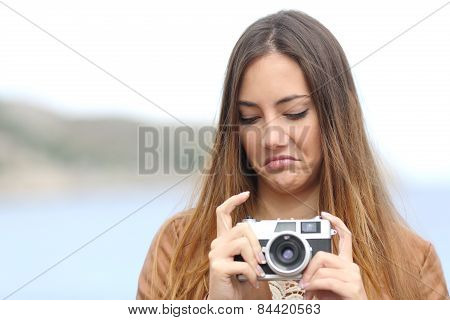 Upset Woman Looking Her Old Slr Photo Camera