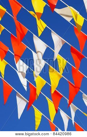 Multiple Strings, Colorful, Triangular Banner Flags, Clear Blue Sky