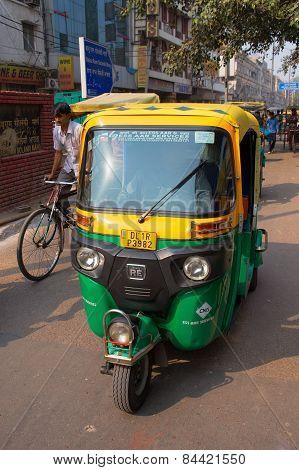 Delhi, India - November 5: Unidentified Man Drives Tuk-tuk On November 5, 2014 In Delhi, India. Auto