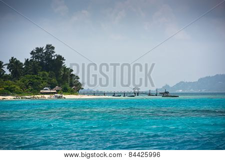 View Of Seychelles Coastline With A Boat Pier