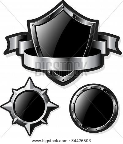 Set of steel glossy shields isolated on white