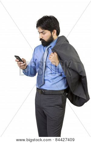 Indian confident young businessman using cell phone ,isolated on white background