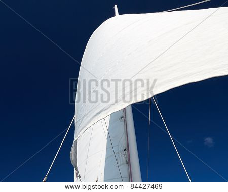 White Sail against Blue Sky