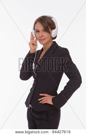 Businesswoman with earphones on white