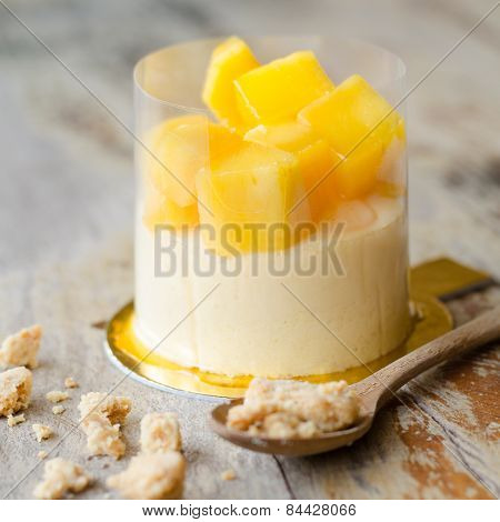 Mango Cheesecake On Wooden Table