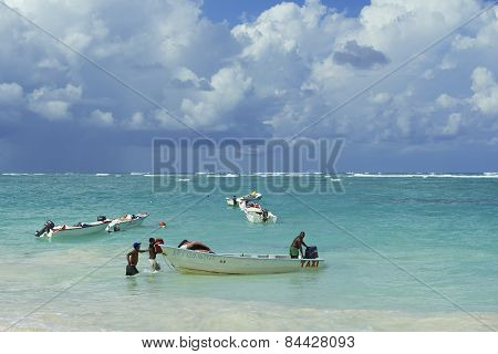 People load taxi boat in Punto Cana, Dominican Republic.