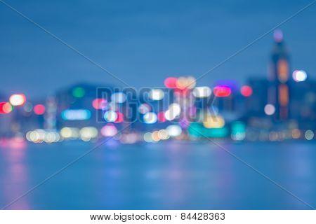 Night lights bokeh of Hongkong city with water reflexion