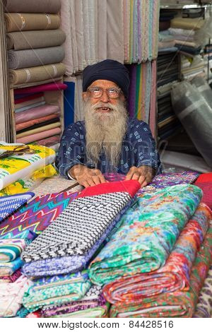 Delhi, India - November 5: Unidentified Man Sells Textile At Chandni Chowk On November 5, 2014 In De