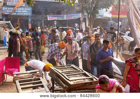 Delhi, India - November 5: Unidentified People Clean Street After Guru Nanak Gurpurab Celebration On