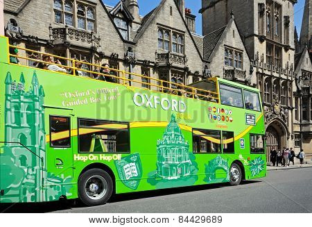 Green open topped Oxford Bus.
