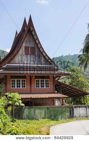 Little Thai Houses And Palm Trees