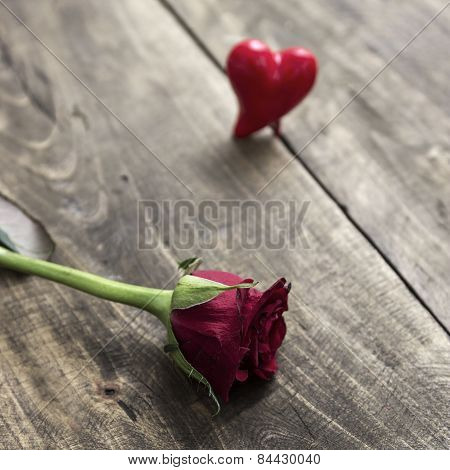 Rose On A Wooden Table