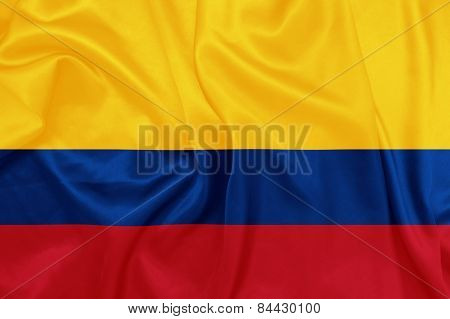 Colombia - Waving national flag on silk texture