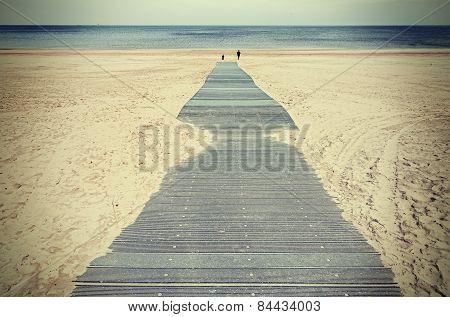 Retro Toned Photo Of A Boardwalk On Beach.