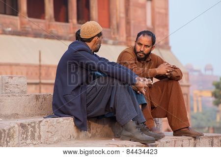 Delhi, India - November 5: Unidentified Men Sit On The Stairs Of Jama Masjid On November 5, 2014 In