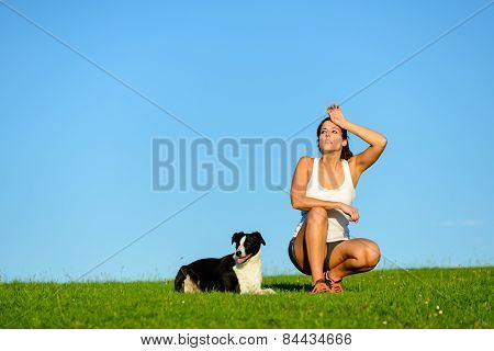 Tired Sporty Athlete Taking A Training Break With Her Dog