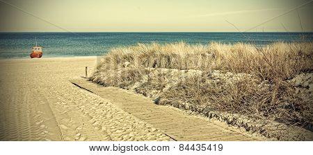 Retro Toned Panoramic Photo Of A Beach.