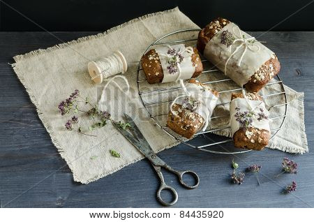 Homemade Bread With Apples In Wrapping Paper On Grid