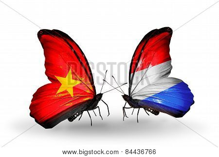 Two Butterflies With Flags On Wings As Symbol Of Relations Vietnam And Luxembourg