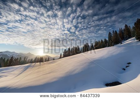 cloudy sky at winter snow landscape in tirol mountains