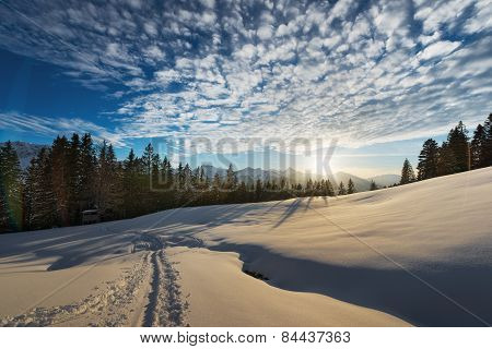 soft light on snow while sunset in austrian landscape