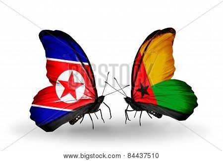 Two Butterflies With Flags On Wings As Symbol Of Relations North Korea And Guinea Bissau